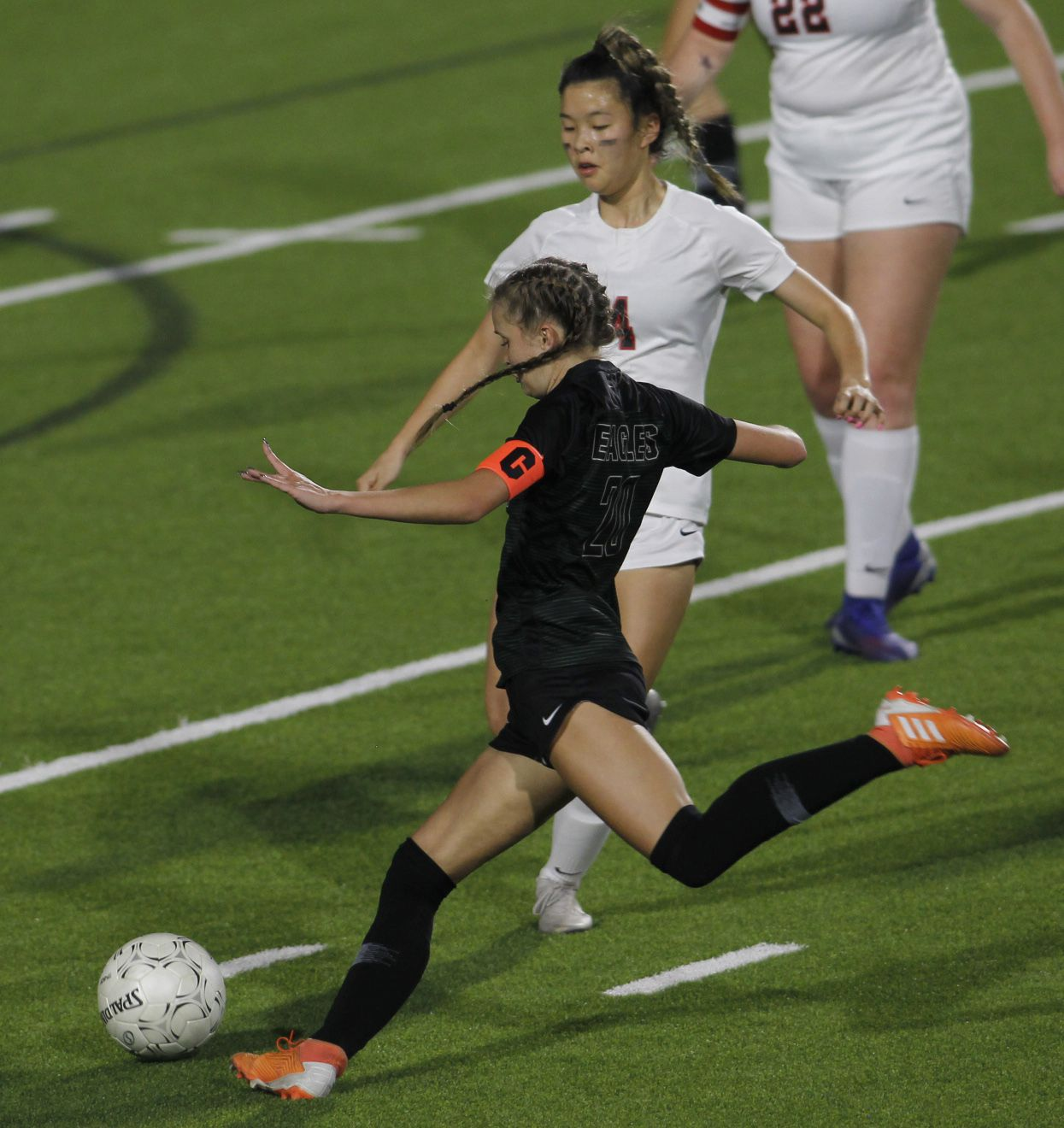 Prosper's Reaganne Crane (20) prepares to fire a shot on goal as Coppell's Michelle Pak (4) moves in defensively during first half action. The two teams played their Class 6A bi-district girls soccer playoff game at McKinney ISD Stadium in McKinney on March 26, 2021. (Steve Hamm/ Special Contributor)