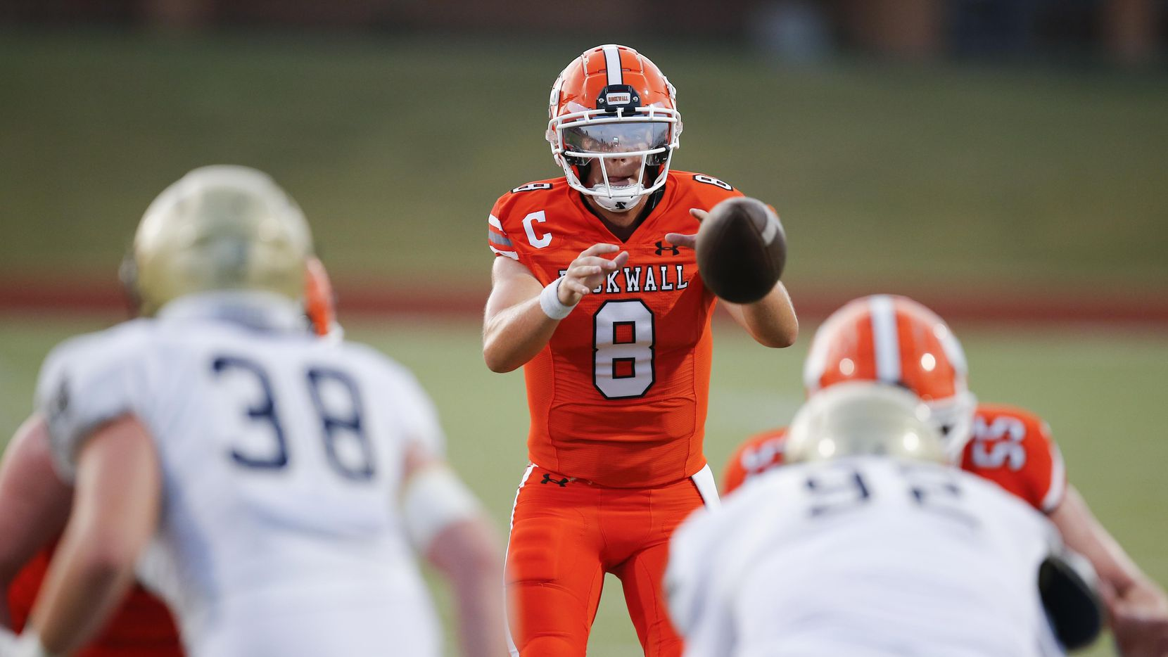 Rockwall senior quarterback Braedyn Locke (8) catches the snap during the first half of a high school football game against Jesuit at Wilkerson-Sanders Stadium in Rockwall, Friday, September 3, 2021.