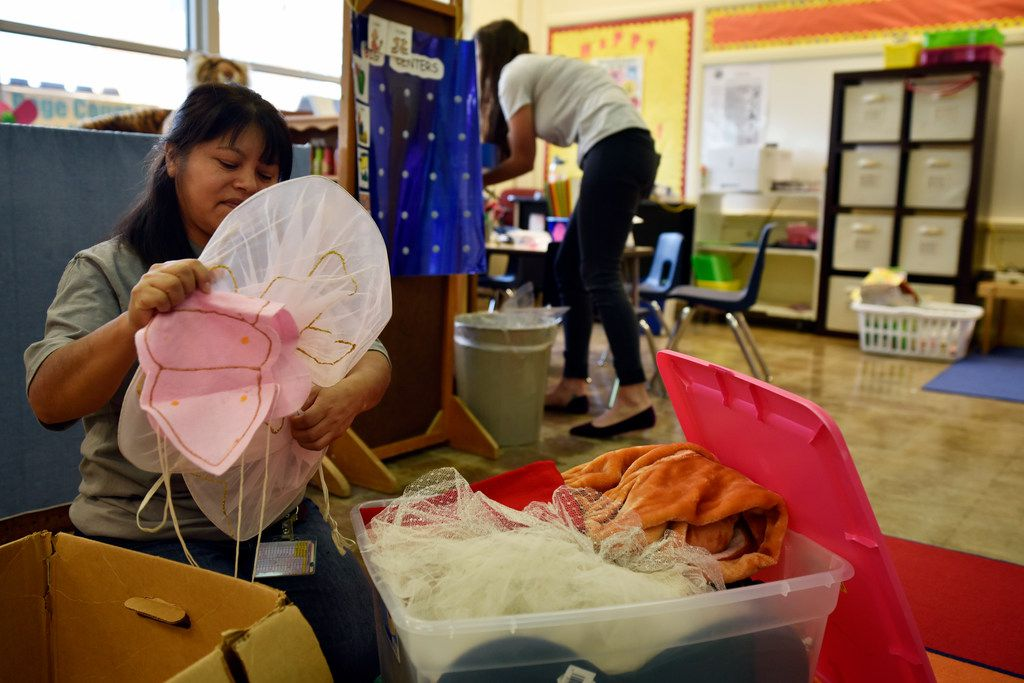 Teacher assistants Alicia Leon (left) and Lyndsey Patman prepare a shared classroom by digging through boxes of costumes for the first day of school at Terrance Elementary on Thursday in Richardson.  The assistants work in the preschool program for children with disabilities.