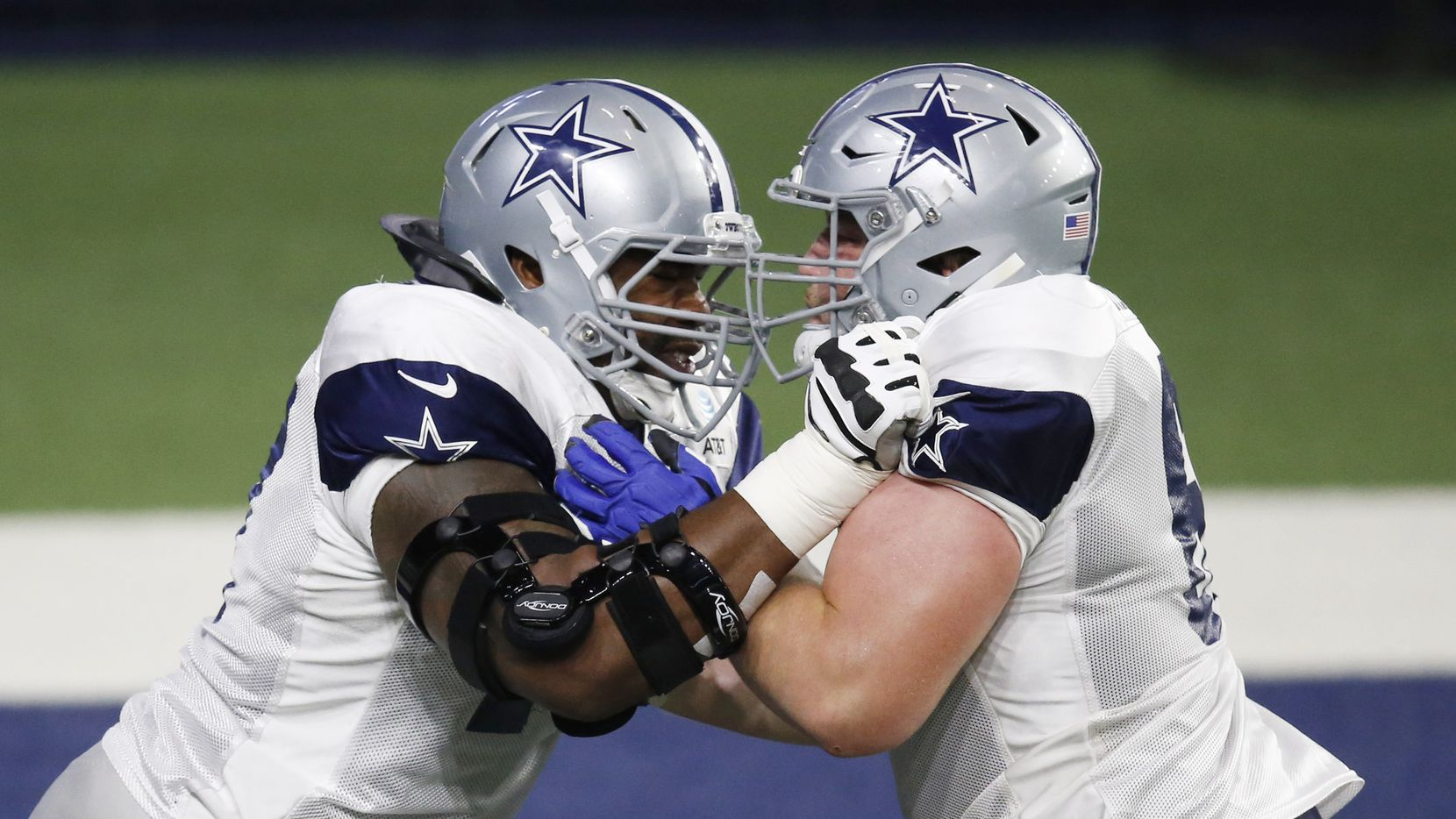 Dallas Cowboys offensive tackle Tyron Smith (77) blocks Dallas Cowboys center Adam Redmond (61) in a drill during training camp at the Dallas Cowboys headquarters at The Star in Frisco, Texas on Thursday, August 27, 2020.