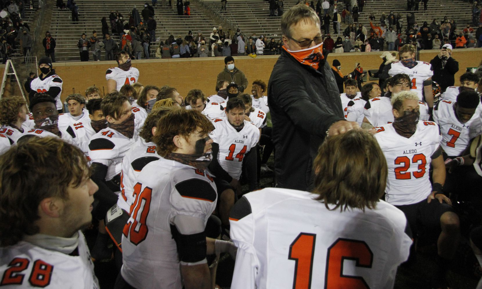 Aledo head coach Tim Buchanan shares words of praise and inspiration following their 55-28 victory over Wichita Fallas Rider to advance to the state tournament. The two teams played their Class 5A Division ll state semifinal football playoff game at Apogee Stadium in Denton on January 8, 2021. (Steve Hamm/ Special Contributor)