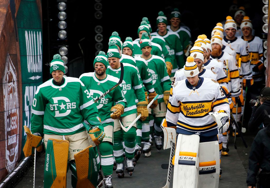 Dallas Stars and Nashville Predators players walk in single file line for warmups before their outdoor NHL Winter Classic hockey game at the Cotton Bowl in Dallas, Wednesday, January 1, 2019. (Tom Fox/The Dallas Morning News)