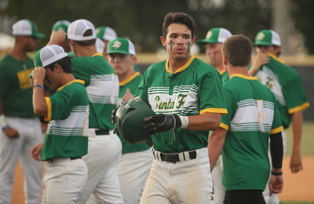 Santa Fe player Tyler Martin prepares for the first at bat of the game during the second game of the best-of-three series in the Class 5A Region III playoff high school baseball game between Santa Fe and Kingwood Park at Jim Kethan Field at Deer Park High School in Deer Park, TX Saturday May 19, 2018. On Friday morning, 10 people were killed and 13 were injured after a shooting at Santa Fe High School. The game was postponed to Saturday after it was scheduled for Friday. Dimitrios Pagourtzis was booked into the Galveston County Jail on capital murder charges.
