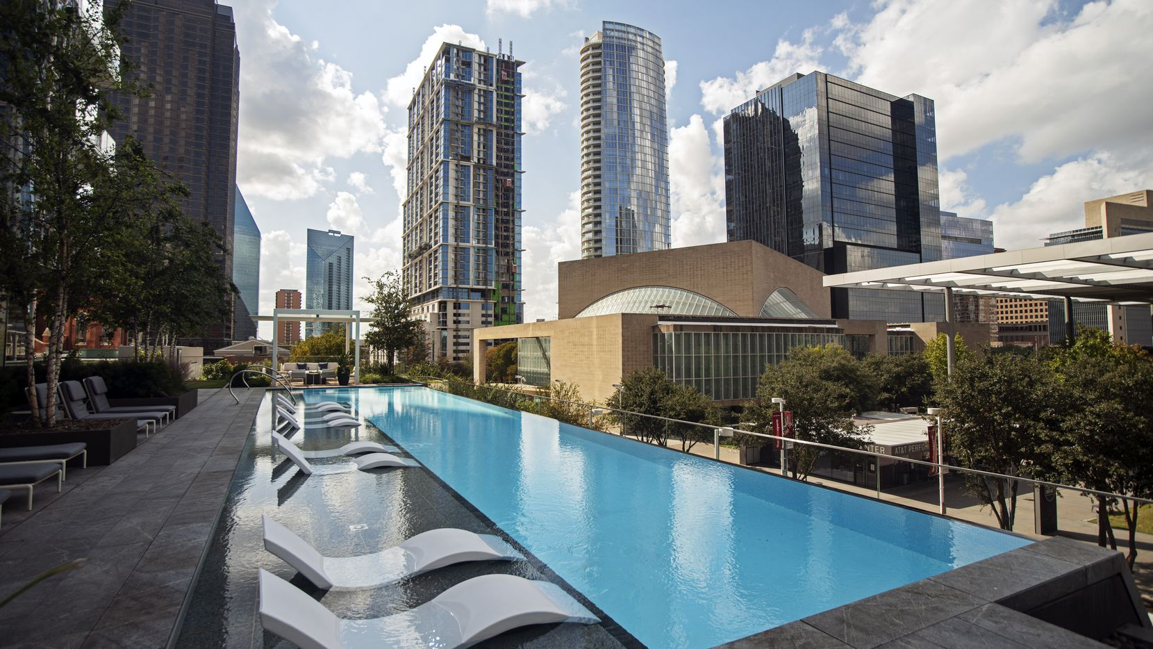 The Hall Arts Residences' infinity edge lap pool with views of the Arts District and downtown Dallas.