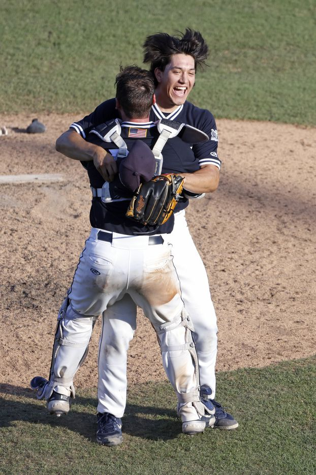 Dallas Baptist pitcher Dominic Hamel (27) and teammate and catcher Christian Boulware (12) celebrate the teamÕs 8-5 win over Oregon St. following the NCAA Division I Baseball Regional Championship game in Fort Worth, Texas on June 7, 2021. (Ron Jenkins/Special Contributor)