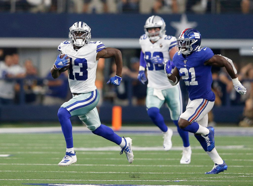 Dallas Cowboys wide receiver Michael Gallup (13) runs up the field after the catch as he is chased by New York Giants free safety Jabrill Peppers (21) during the second half of play at AT&T Stadium in Arlington, Texas on Sunday, September 8, 2019. Dallas Cowboys defeated the New York Giants 35-17 in the home opener.