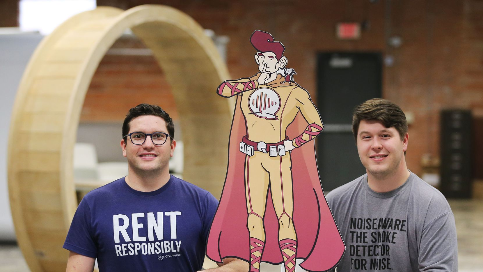 Dave Krauss (left) and Andrew Schulz, the co-founders of NoiseAware, helped to create a device to provide noise protection for short term and vacation rental properties. The co-founders were photographed with the company mascot, Quiet Man, in their Deep Ellum office in Dallas January 3, 2017. (Andy Jacobsohn/The Dallas Morning News)