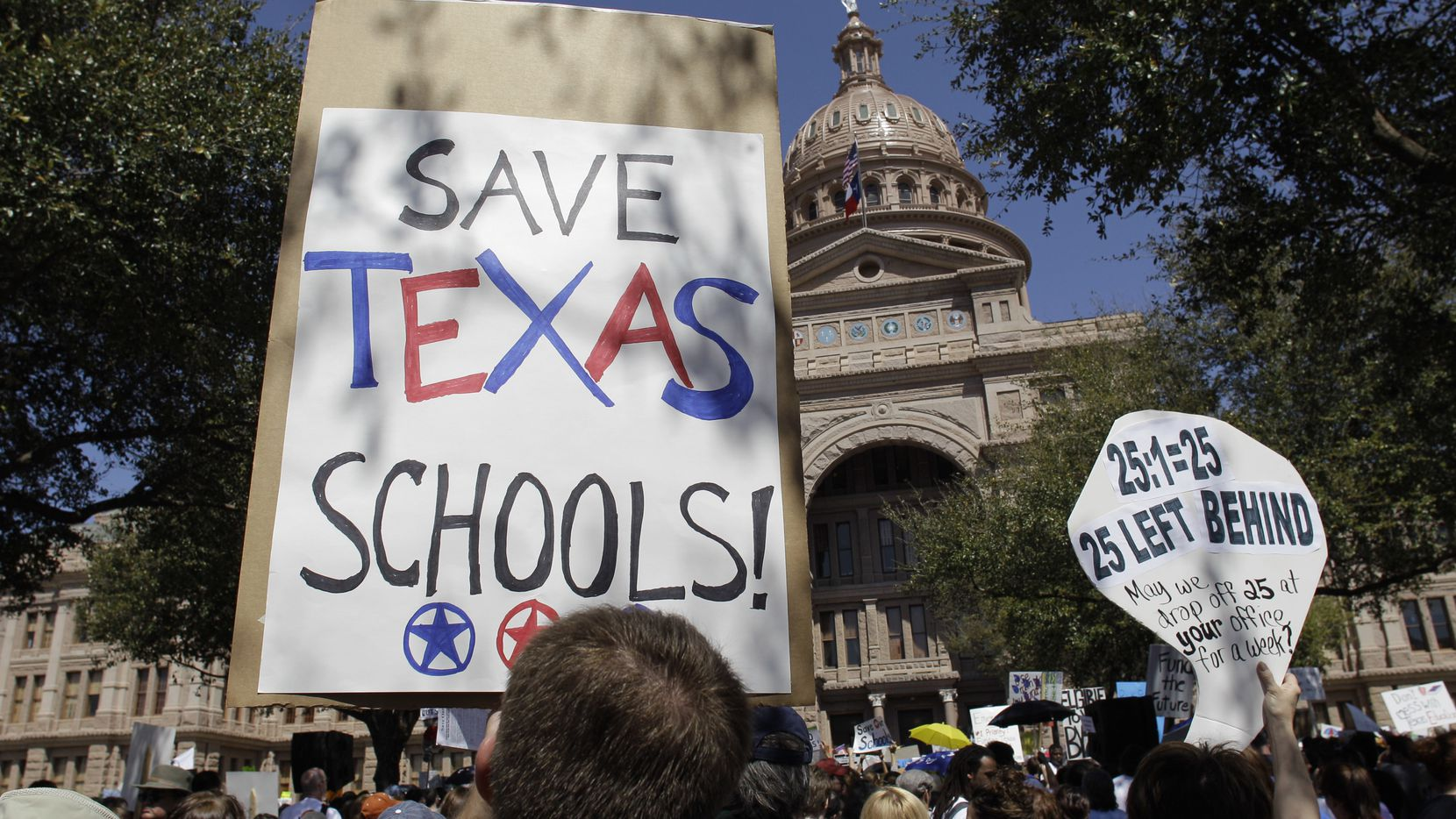 Teachers, students and parents take part in a school rally, Saturday, March 12, 2011, in Austin, Texas. Thousands rallied at the Texas Capitol on Saturday to protest $10 billion in education cuts they say will ruin public schools. (AP Photo/Eric Gay)