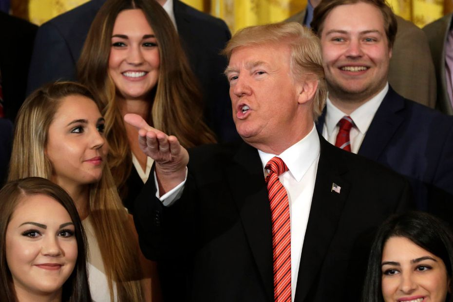 US President Donald Trump gestures during a group photo with outgoing interns at the White House (Yuri Gripas/Getty Images)