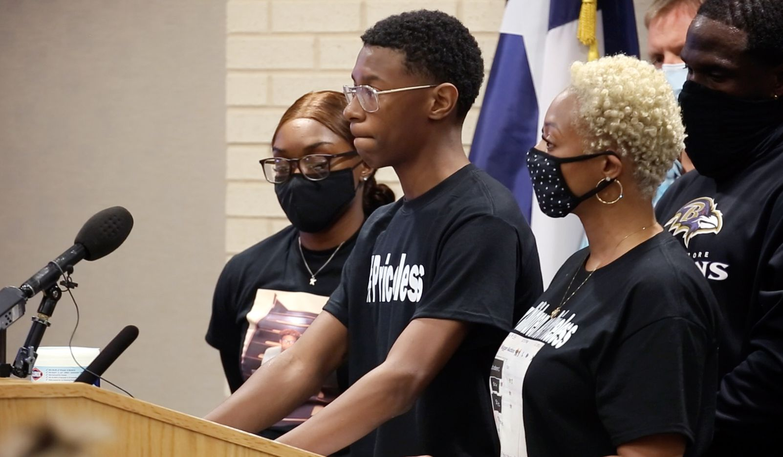 """Ninth-grader Christopher Johnson, who was targeted in a racial Snapchat group with multiple names, including """"Slave Trade"""" and another that included a racial slur, speaks to Aledo ISD board members, president and superintendent about his experience, Monday evening, April 19, 2021. His mother Mioshi Johnson (right) stood by his side. Christopher and another African-American boy were the targets of a social media post last week. (Tom Fox/The Dallas Morning News)"""