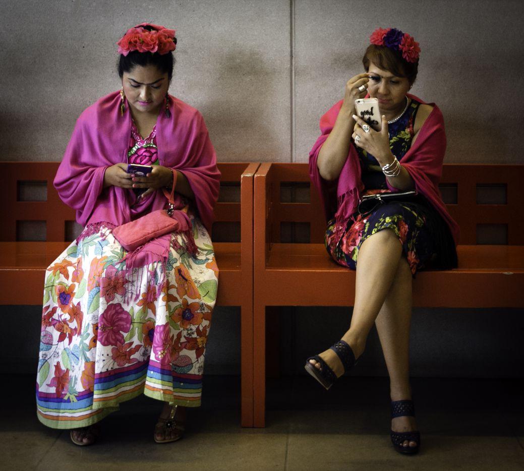 Elizabeth Martinez (right) applies makeup before the Frida Fest.