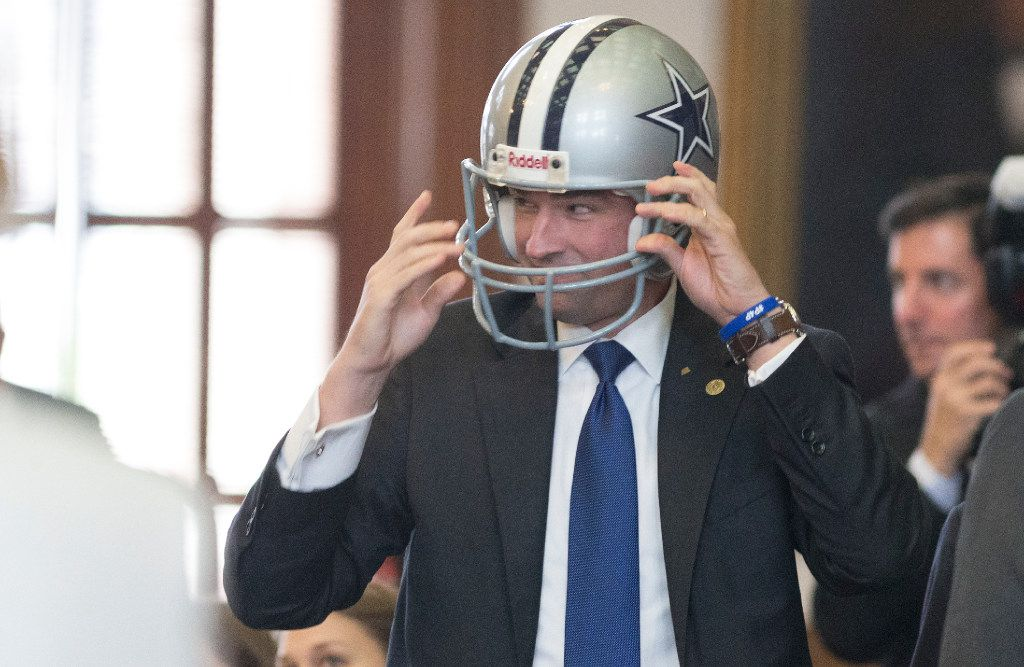 Rep. Jeff Leach, R-Plano, prepares to recognize former Dallas Cowboys quarterback Tony Romo at the Texas Capitol in Austin, Wednesday, May 3, 2017.