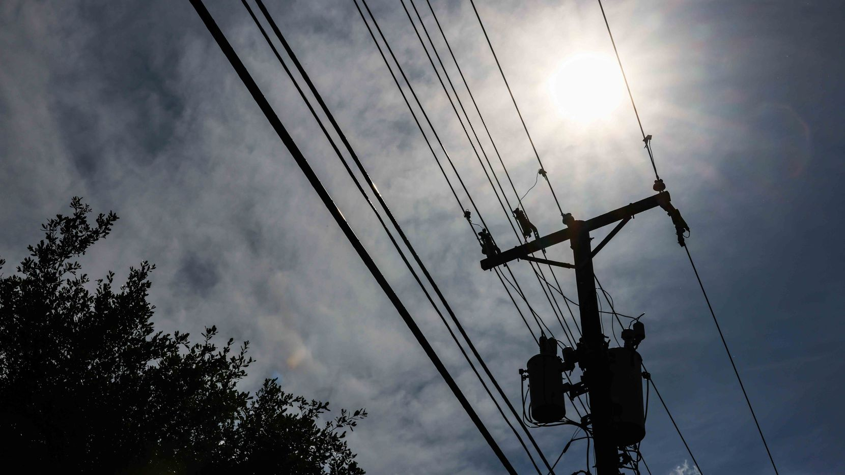 Temperatures reach 97 degrees with a sensation of 105 degrees in Dallas on Monday afternoon, June 14, 2021, as ERCOT send a conservation alert asking Texans to reduce electric use through Friday.
