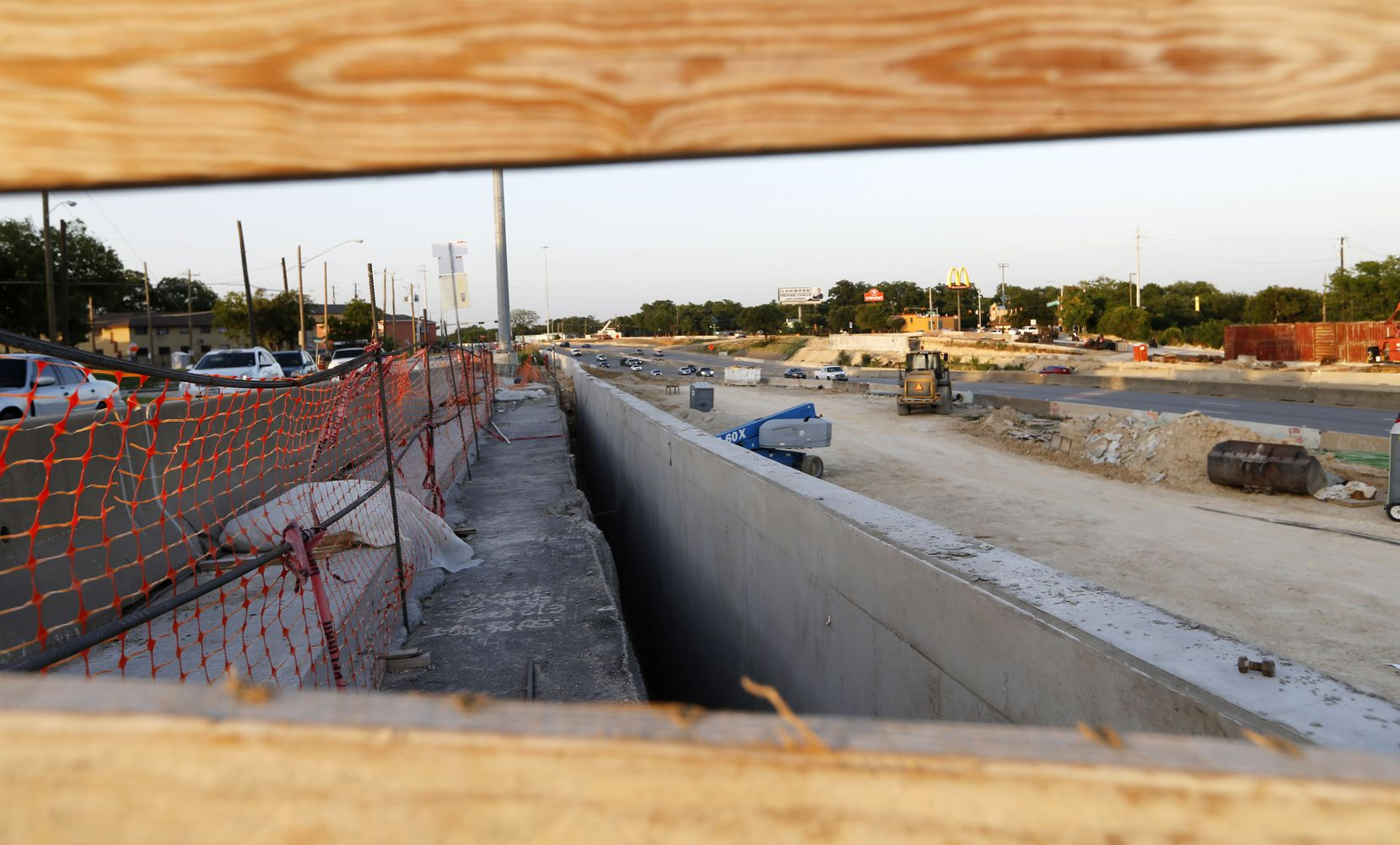 "A construction area for the Southern Gateway deck park's concrete foundation is visible at the intersection of Marsalis Ave and I-35E. TxDOT has been working on the park's infrastructure for for more than six months and expects to have the ""platform"" built by summer 2022."