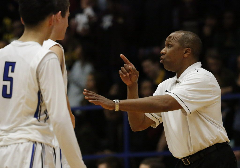 Plano West head coach Anthony Morgan speaks to his players in the second half during a high school basketball game between Plano East and Plano West in Plano, Texas Friday January 16, 2015. Plano West beat Plano East 79-62.