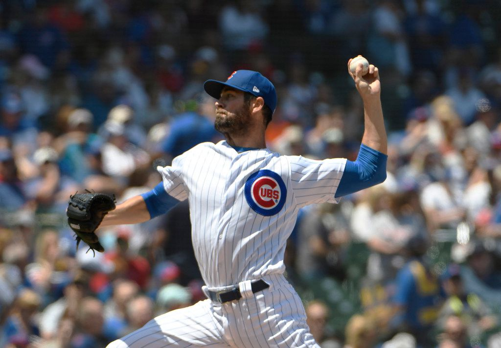 Chicago Cubs starting pitcher Cole Hamels (35) delivers against the St. Louis Cardinals during the first inning of a baseball game, Friday, June, 7, 2019, in Chicago. (AP Photo/David Banks)