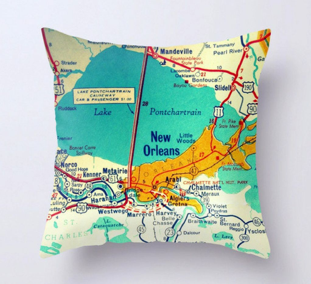 Bright tropical colors make Vintage Beach Maps' pillows stand out on a couch. Pick your place and they'll make what you want. VACATIONBOX
