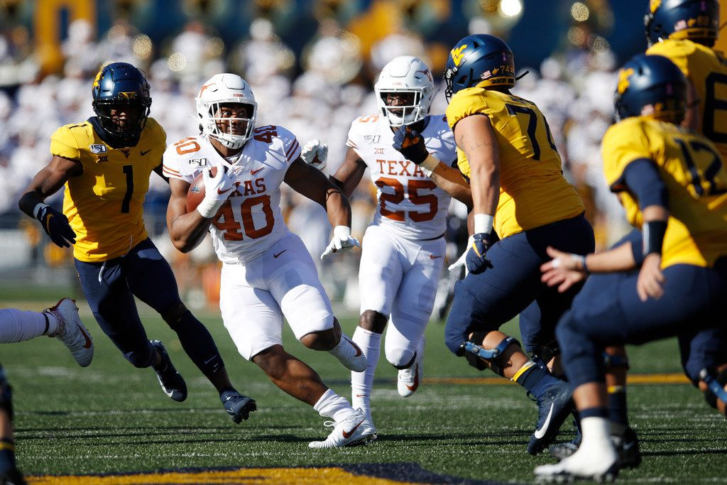 MORGANTOWN, WV - OCTOBER 05: Ayodele Adeoye #40 of the Texas Longhorns runs with the ball after intercepting a pass in the first quarter against the West Virginia Mountaineers at Mountaineer Field on October 5, 2019 in Morgantown, West Virginia. (Photo by Joe Robbins/Getty Images)