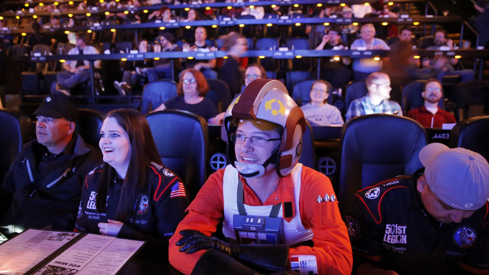 Jacob Degan of College Station, Texas, dressed as Star Wars X-wing Starfighter character, enjoys the pre show entertainment before the first showing of Star Wars: The Force Awakens movie at the Alamo Drafthouse Cinema in Richardson.