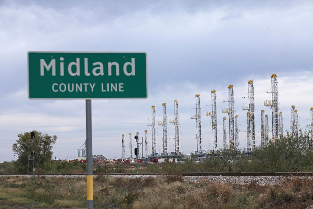 Numerous oil rigs stand idle at the Midland County Line Thursday, Nov. 17, 2016, in Midland, Texas. The U.S. Geological Survey has determined that the vast shale field in West Texas could yield 20 billion barrels of oil, making it the largest source of shale oil the agency has ever assessed. The agency said in a release Nov. 15 that the Wolfcamp Shale geologic formation in the Midland area also contains an estimated 16 trillion cubic feet of natural gas. (Jacob Ford/Odessa American via AP)