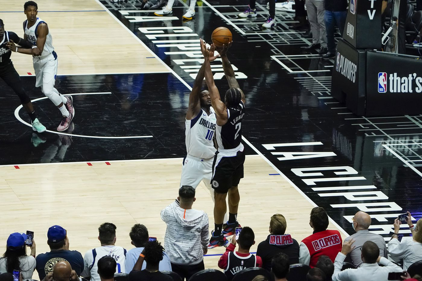LA Clippers forward Kawhi Leonard (2) misses a 3-point attempt over Dallas Mavericks forward Dorian Finney-Smith (10) with 4.9 seconds left during the fourth quarter of an NBA playoff basketball game at the Staples Center on Wednesday, June 2, 2021, in Los Angeles. The Mavericks won the game 105-100. (Smiley N. Pool/The Dallas Morning News)