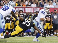 Dallas Cowboys quarterback Garrett Gilbert (3) rolls out against Pittsburgh Steelers safety Antoine Brooks Jr (25) during the first quarter of their preseason game at Tom Benson Hall of Fame Stadium in Canton, Ohio, Thursday, August 5, 2021.