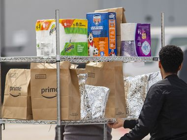 Amazon workers filled orders at a Dallas facility last month. Since the pandemic, the Dallas-Fort Worth area has added over 11,000 jobs in transportation, warehousing and utilities, the sector that includes many e-commerce companies.
