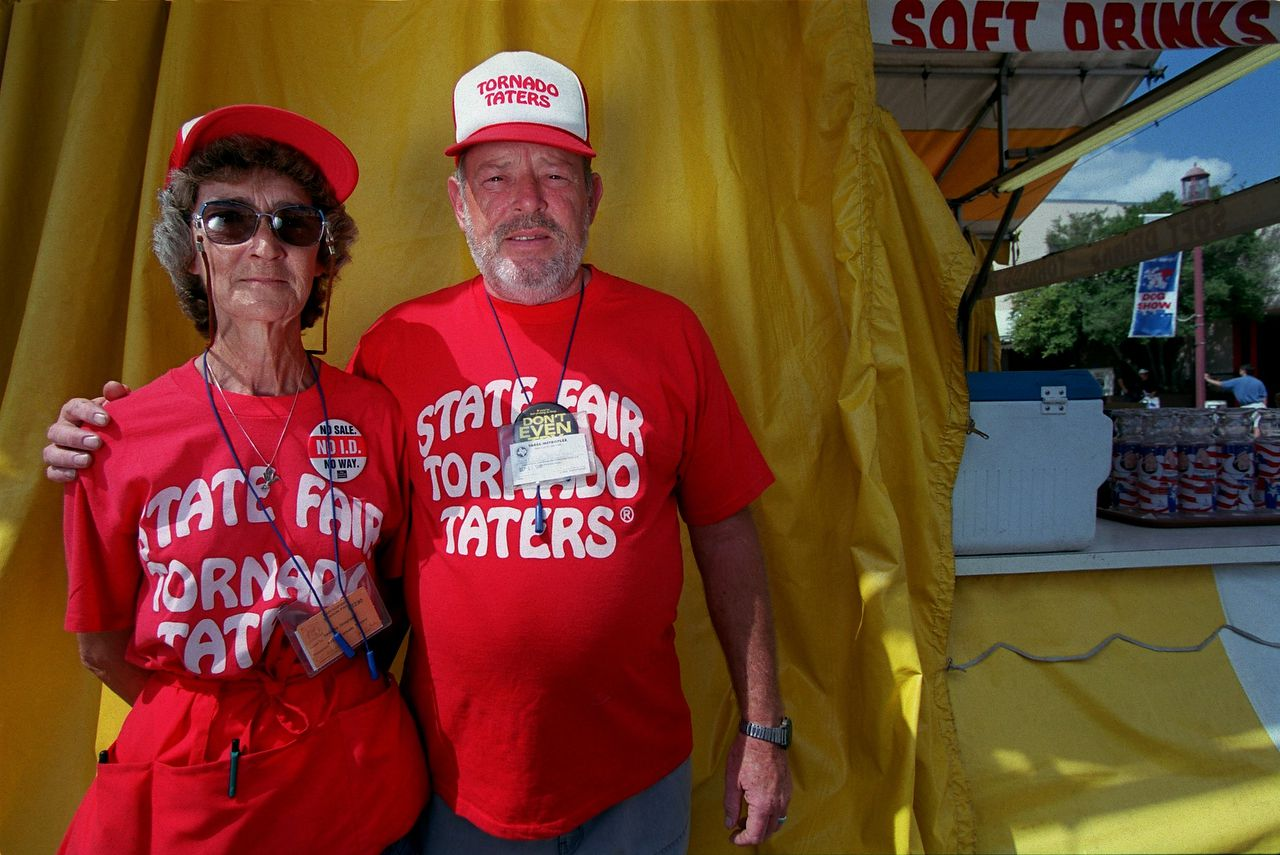 """LaDonna and Lyle Douglas have managed the """"Tornado Tater"""" booth at the Texas State Fair for five years. They spend the rest of the year in Tuscola, Ill. Photo taken at the State Fair of Texas in 1999."""