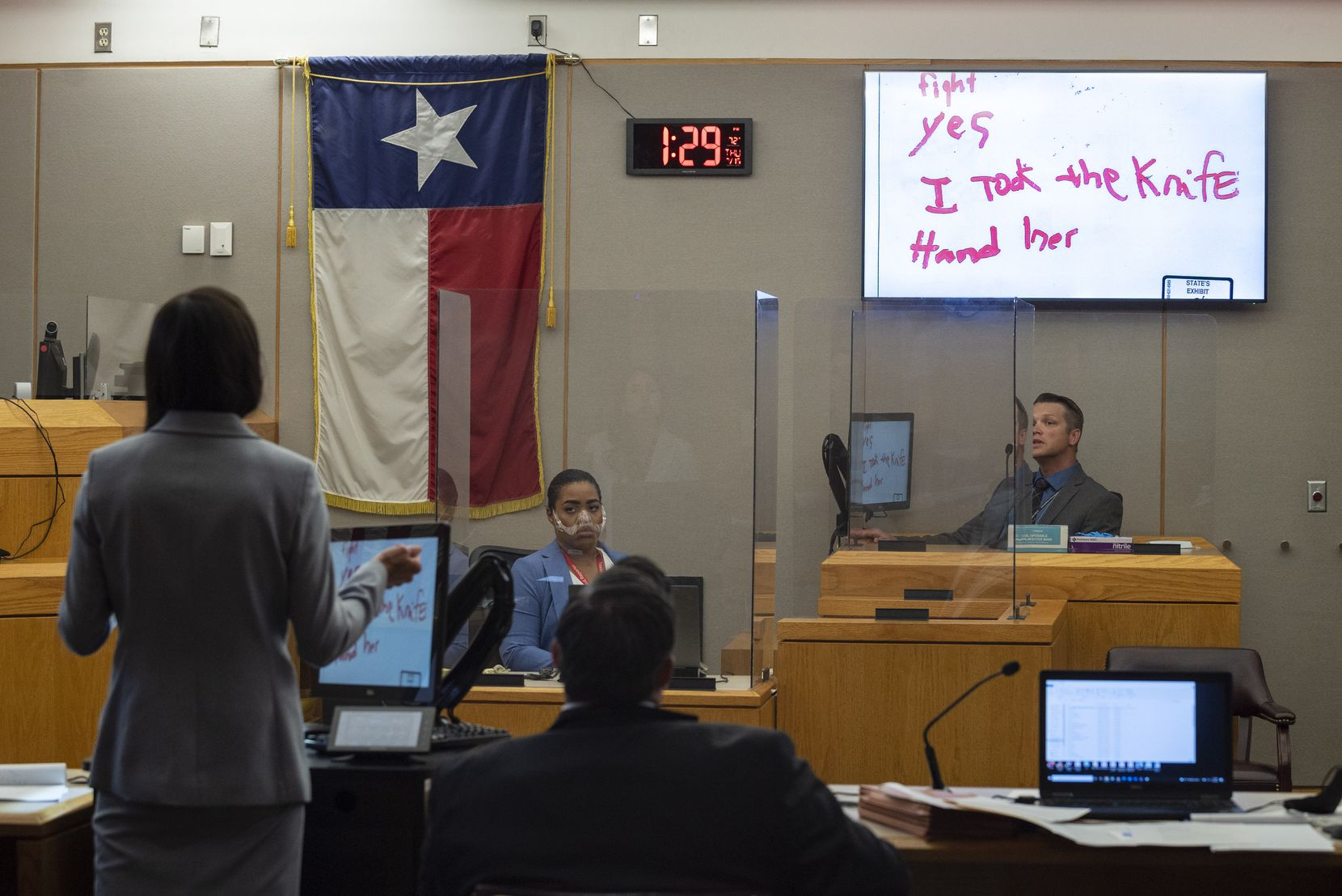 """Cedar Hill Police Detective Adren Allen testifies during the murder trial of Curtis Bullock inside the 256th District Court with Judge Jennifer Bennett at the Frank Crowley Criminal Courts Building in Dallas, on Thursday, July 15, 2021. The hand writing shown on the screen inside the court room is that of Curtis Bullock having a conversation with the detective. Bullock told Detective Adren, """"I took the knife."""""""