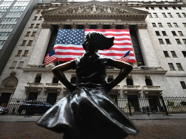 The Fearless Girl statue stands in front of the New York Stock Exchange near Wall Street.
