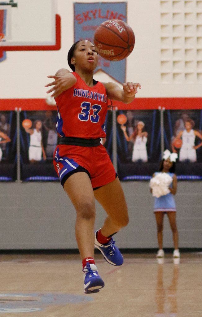 Duncanville's Nyah Wilson (33) delivers a running pass to a teammate during first half action against Dallas Skyline. The two teams played their girls basketball game at  Skyline High School in Dallas on January 7, 2020. (Steve Hamm/ Special Contributor)