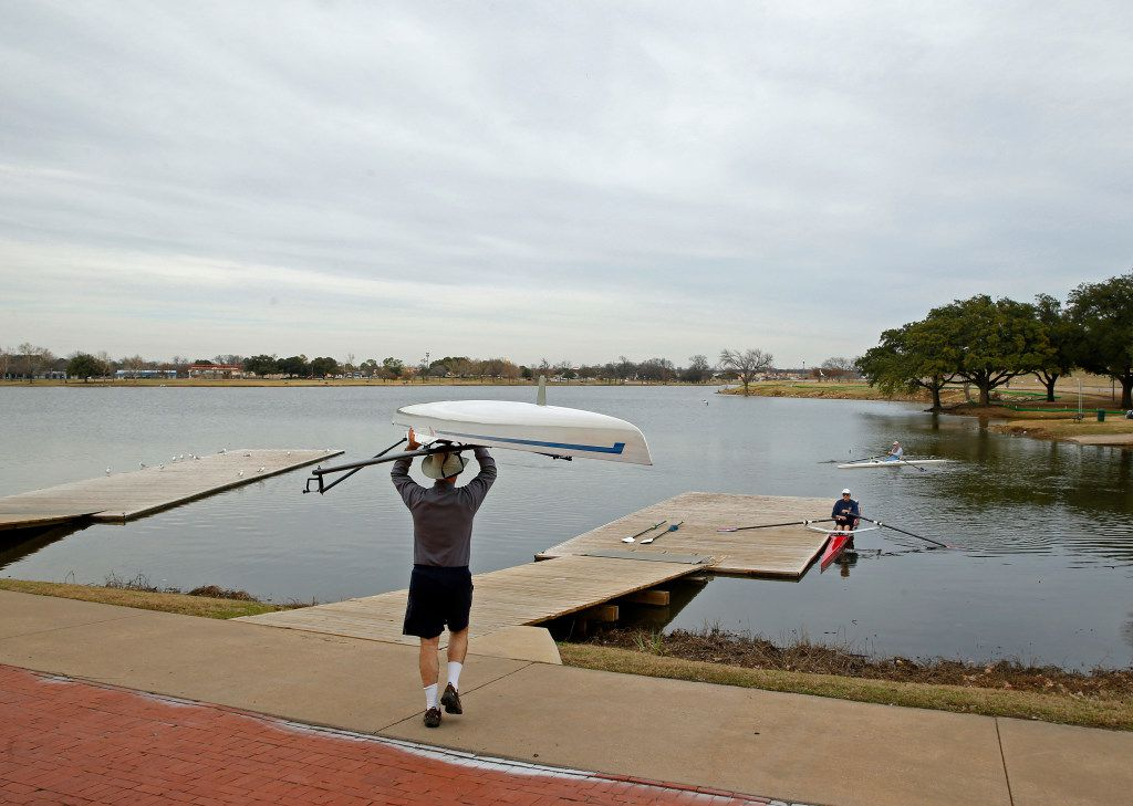 Dallas Rowing Club member Patrick Genevein takes his boat out for a workout at Bachman Lake in Dallas on January 24.