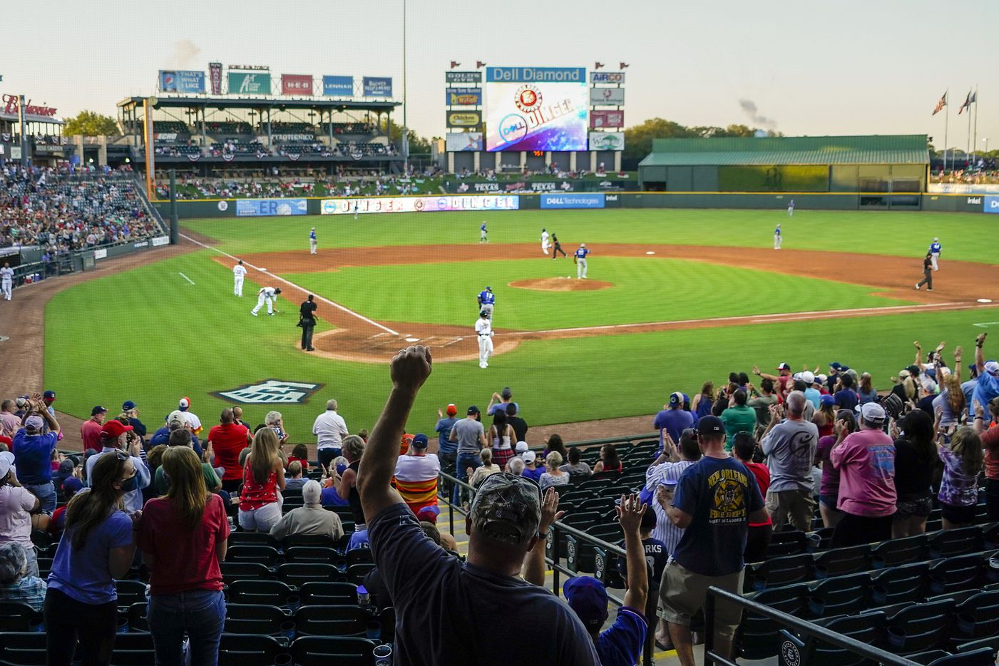 Fans cheer a 2-run home run by Round Rock Express infielder Charles Leblanc during the second inning against the Oklahoma City Dodgers at Dell Diamond on Thursday, May 6, 2021, in Round Rock, Texas.