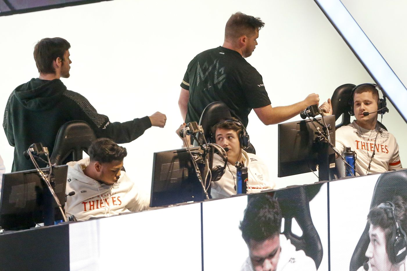 Members of Dallas Empire greet members of Los Angeles Thieves after a match during the Call of Duty League Major V tournament at Esports Stadium Arlington on Saturday, July 31, 2021, in Arlington. Empire defeated Thieves 3-1 to advance in the tournament. (Elias Valverde II/The Dallas Morning News)