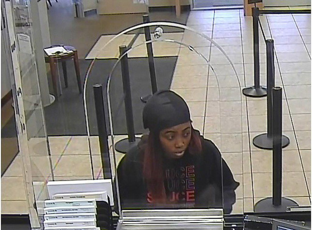 Arlington police released surveillance footage of a woman suspected of robbing several banks in the past week.