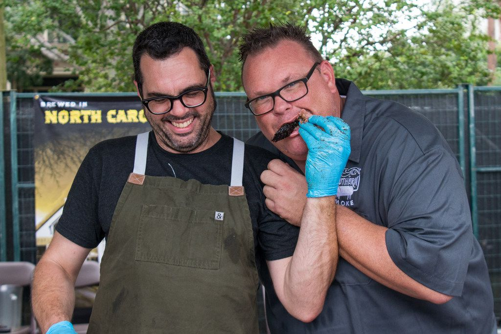 Aaron Franklin, a Southern Smoke participant since the inaugural festival, feeds Chris Shepherd brisket at the 2018 festival. Southern Smoke 2018 raises over $425,000 for charity at its 3rd annual event in Houston on Sept. 30, 2018.