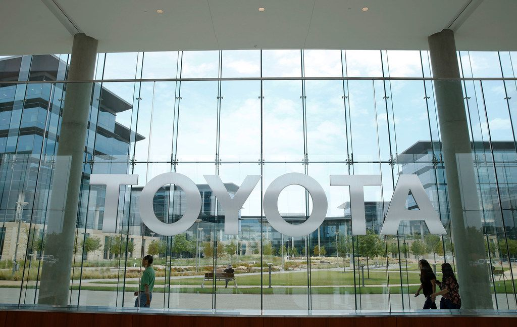 Toyota employees walk by the lobby area at Toyota Motors North America in Plano in this file photo. The manufacturer is one of the largest employers in the city.