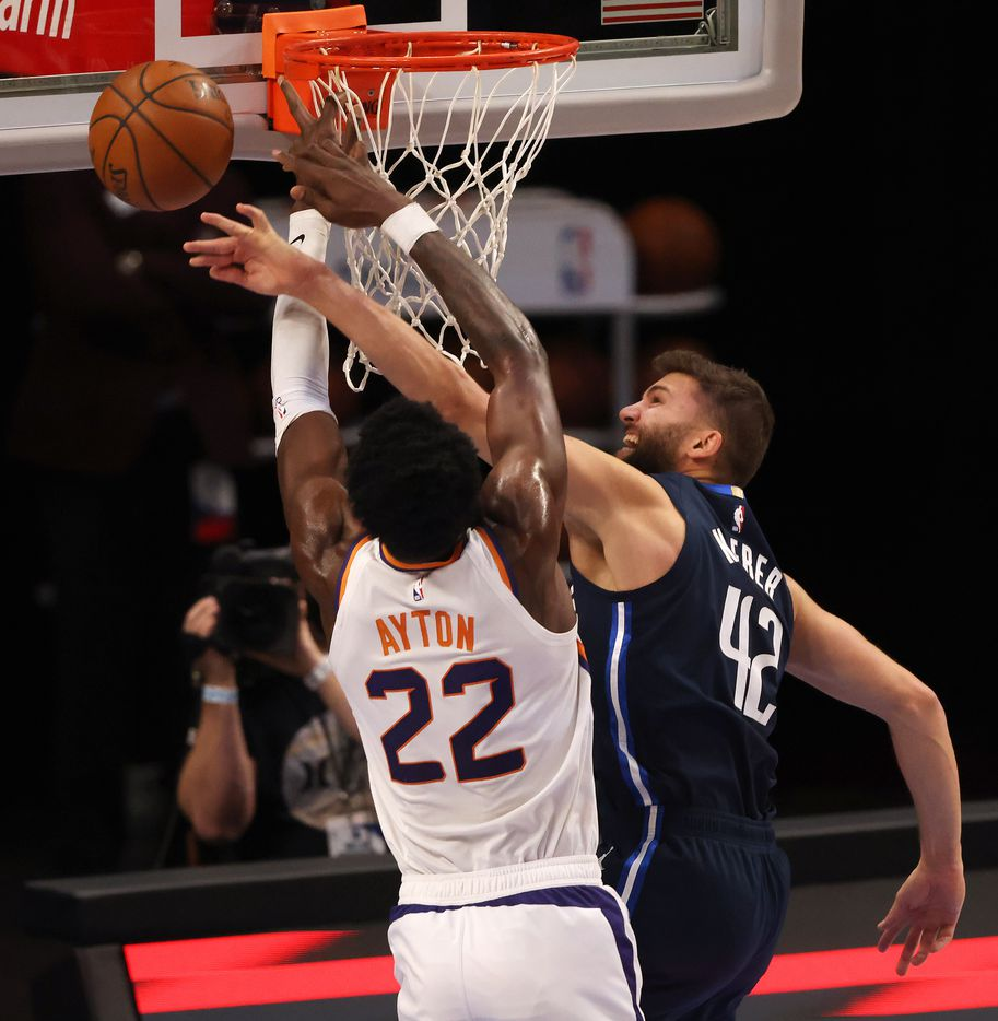 Dallas Mavericks forward Maxi Kleber (42) blocks a shot from Phoenix Suns center Deandre Ayton (22) during the first quarter of play at American Airlines Center on Monday, February 1, 2021in Dallas. (Vernon Bryant/The Dallas Morning News)