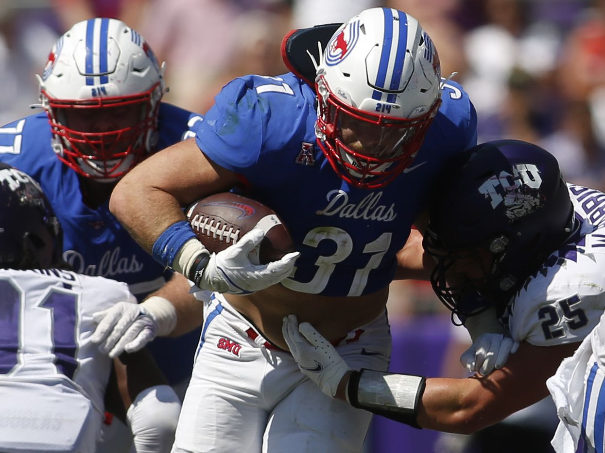 SMU running back Tyler Lavine (31) breaks into the secondary as TCU linebacker Wyatt Harris (25) moves in to make the tackle during 4th quarter action. SMU won 42-34. The two teams played their NCAA football game at Amon G. Carter Stadium on the campus of TCU in Fort Worth on September 25, 2021. (Steve Hamm/ Special Contributor)