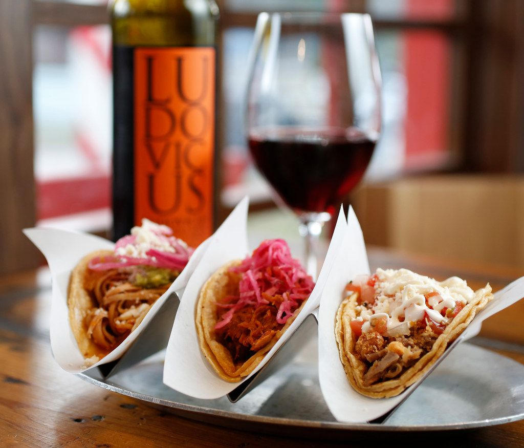 Tacos (from left) chicken tinga, chochinita pibil and crispy pork carnitas paired with Ludovicus Garnacha photographed at Taco y Vino in Dallas.