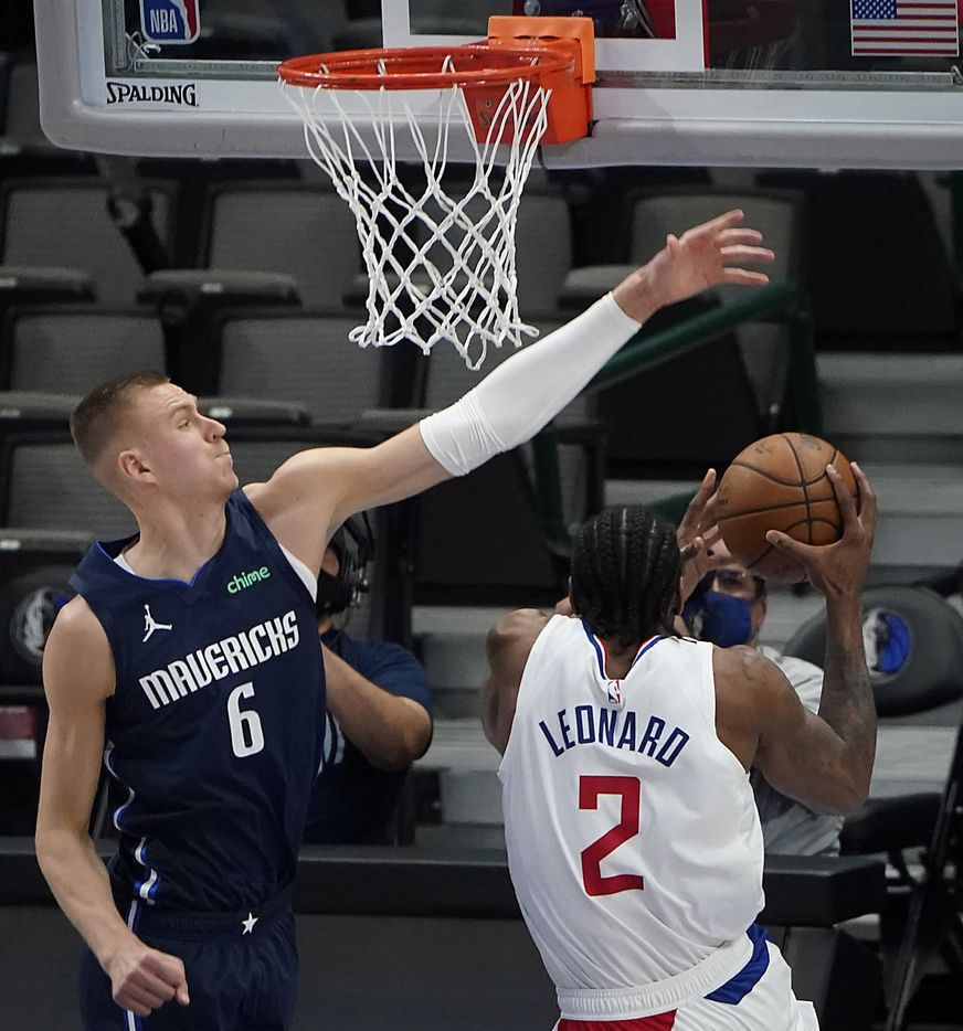 Dallas Mavericks center Kristaps Porzingis (6) defends against LA Clippers forward Kawhi Leonard (2) during the second quarter of an NBA playoff basketball game at American Airlines Center on Friday, May 28, 2021, in Dallas.
