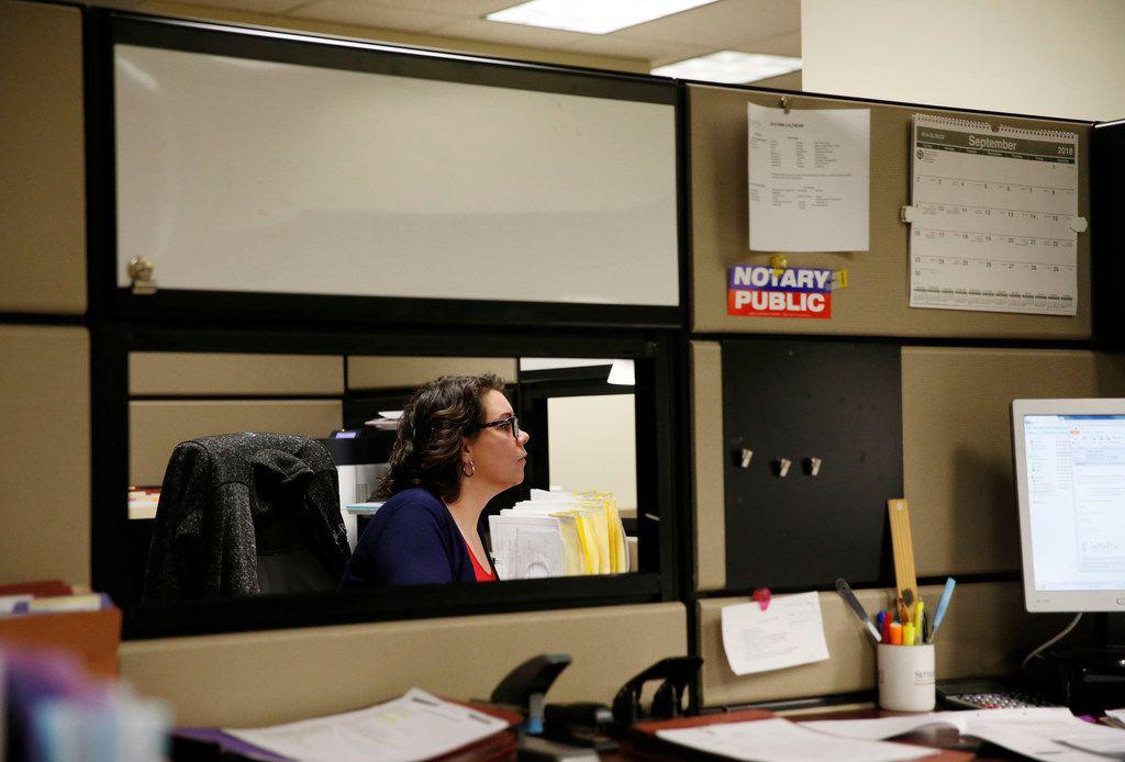 Rebekah Wilson, legal secretary works at her desk at SettlePou.