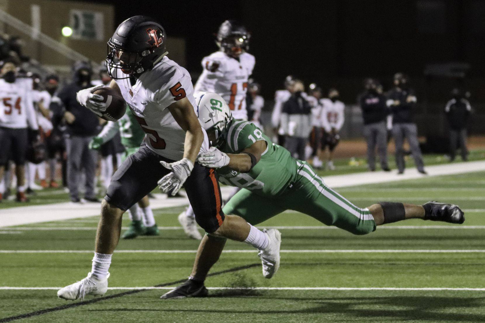 Lake Dallas defensive back Anthony Lunca (19) tries to tackle Frisco Liberty running back Will Ashmore (5) during the second half at Falcon Stadium in Corinth, Texas Friday, October 23, 2020. (Elias Valverde II / Special Contributor)