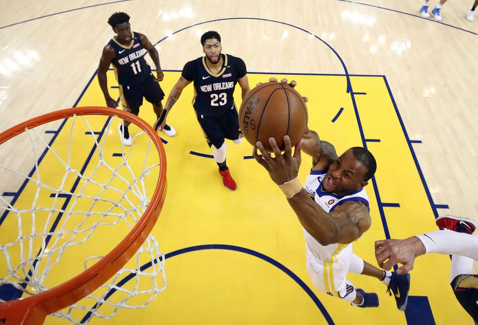 Golden State Warriors' Andre Iguodala, bottom right, goes up for a shot against the New Orleans Pelicans during the first half in Game 5 of an NBA basketball second-round playoff series Tuesday, May 8, 2018, in Oakland, Calif.