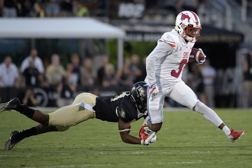 SMU wide receiver James Proche (3) is tackled by Central Florida defensive lineman Brendon Hayes after catching a pass during the first half of an NCAA college football game Saturday, Oct. 6, 2018, in Orlando, Fla. (AP Photo/Phelan M. Ebenhack)