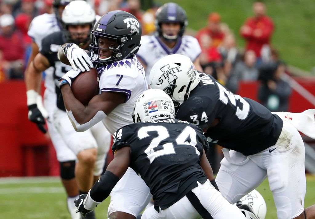 AMES, IA - OCTOBER 5: Wide receiver John Stephens Jr. #7 of the TCU Horned Frogs is tackled by defensive back D.J. Miller #24, and linebacker O'Rien Vance #34 of the Iowa State Cyclones as he rushed for yards in the first half of play at Jack Trice Stadium on October 5, 2019 in Ames, Iowa. (Photo by David Purdy/Getty Images)