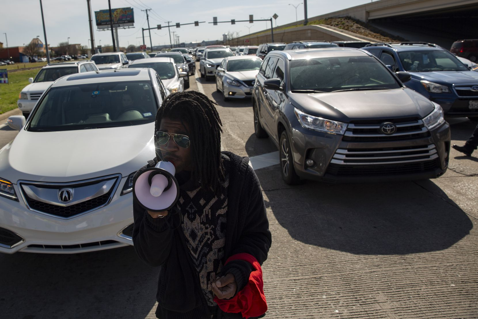 """Quinten Scott thanks people participating in a march outside of the Allen Outlets on Sunday, March 21, 2021 for his older brother Marvin Scott III, who died a week prior while in custody at the Collin County Jail on March 14, 2021. """"I'm just now to a point where I feel I can speak,"""" said Quinten after leading several chants and telling the crowd fond stories of his older brother. (Shelby Tauber/Special Contributor)"""