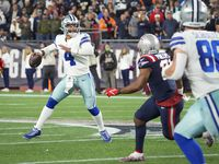 Dallas Cowboys quarterback Dak Prescott (4) throws the game-winning touchdown pass to wide receiver CeeDee Lamb in overtime as he scrambles away from New England Patriots safety Adrian Phillips (21) in an NFL football game on Sunday, Oct. 17, 2021, in Foxborough, Mass.