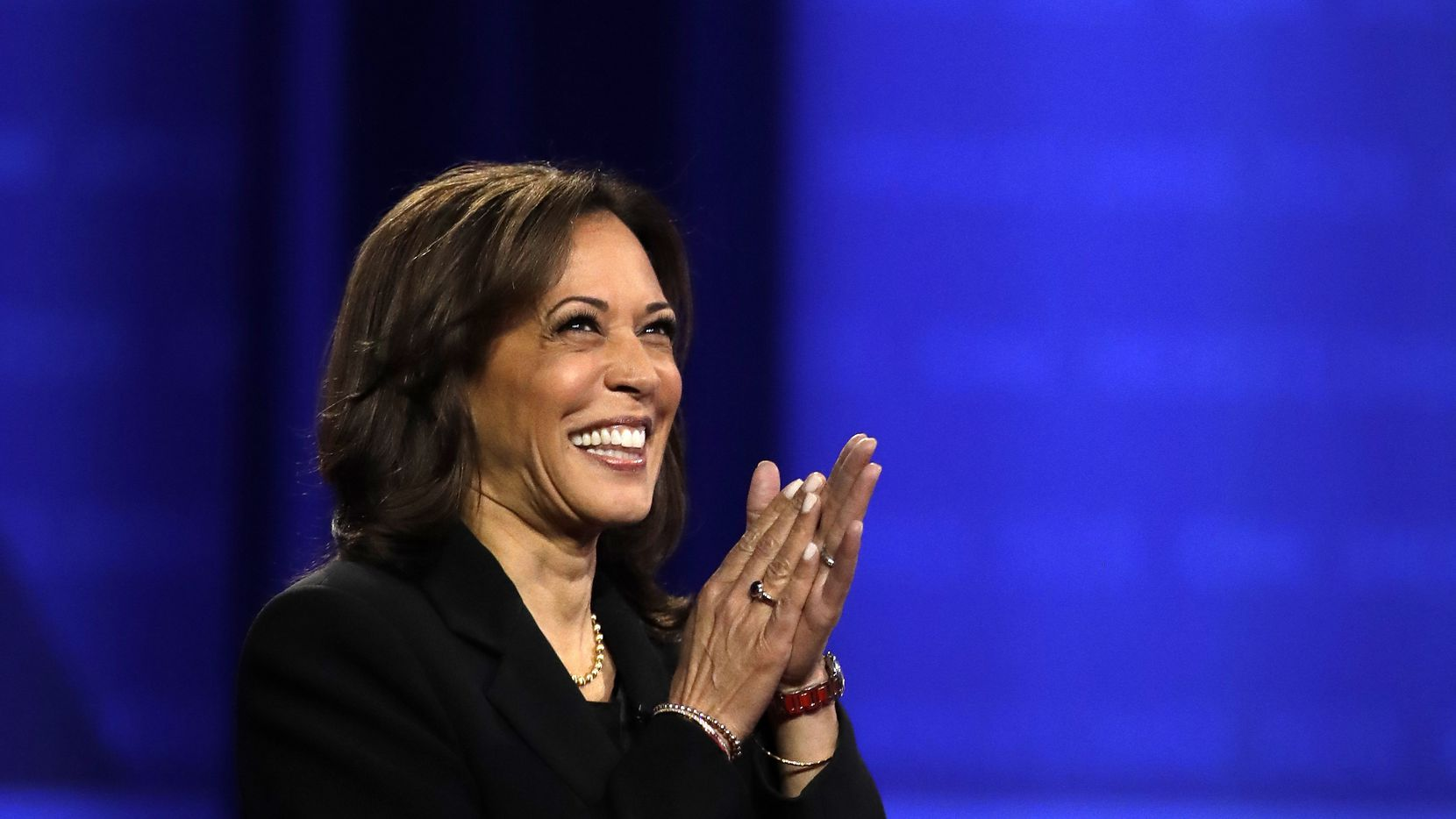 Sen. Kamala Harris, D-Calif., claps as she takes the stage during an October 2019 town hall in Los Angeles.