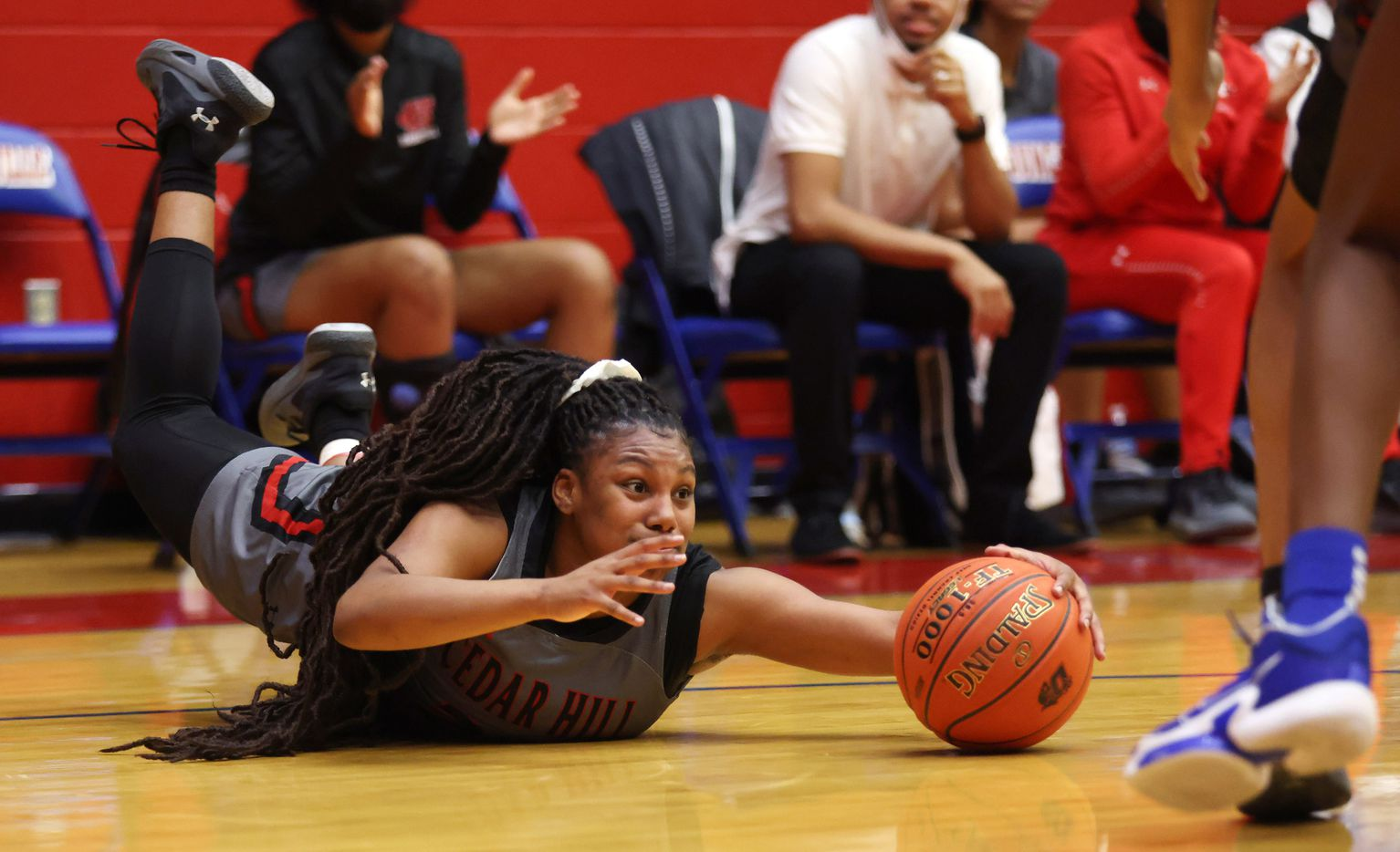 Cedar Hill's Theasia Ebron (23) dives for a loose ball in a game against Duncanville during the first half of play at Sandra Meadows Arena at Duncanville High School on Tuesday, January 12, 2021 in Dallas. (Vernon Bryant/The Dallas Morning News)